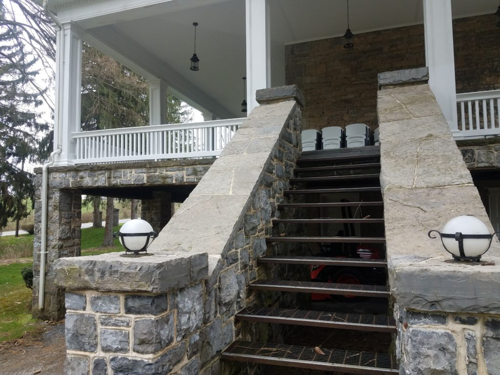 The stairs leading up to the porch